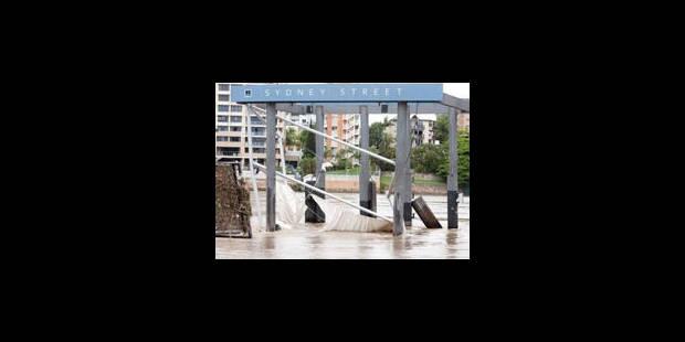 Australie : hommage aux victimes des inondations, évacuations dans le sud - La Libre