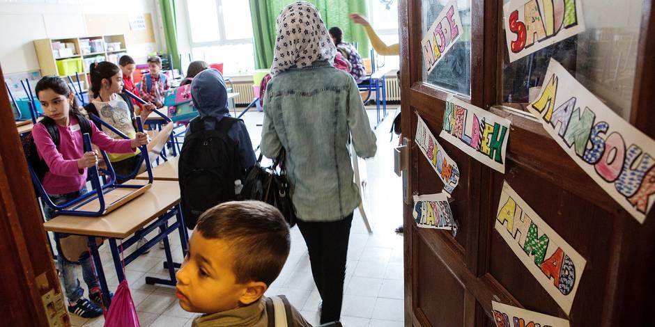 Les petits migrants font aussi leur rentrée - La Libre