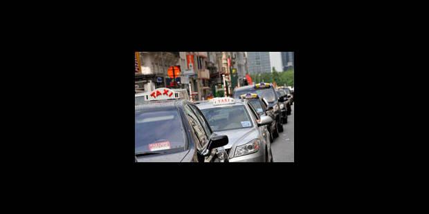 Quelques dizaines de taximen manifestent contre le plan taxi - La Libre