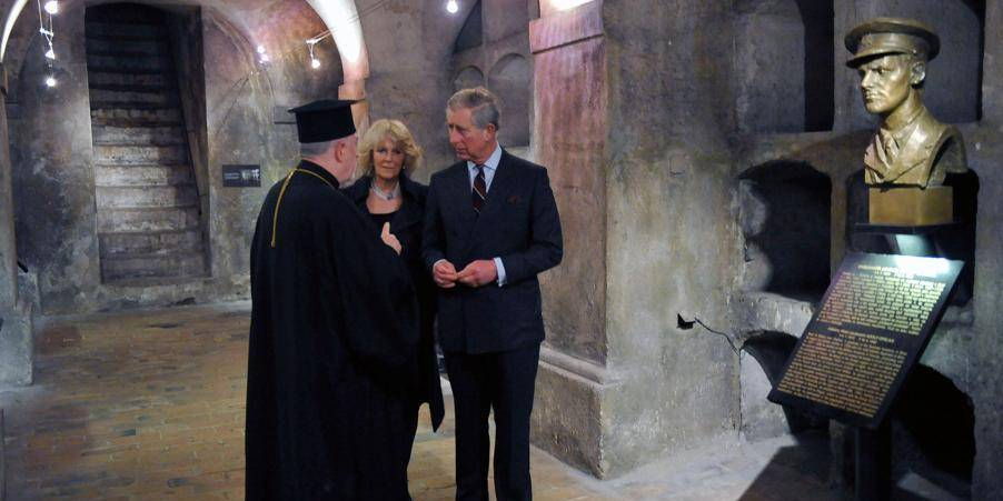 Britain's Prince Charles, The Prince of Wales, right, and his wife Camilla, The Duchess of Cornwall, talk with Jaroslav Suvarsky, Superior of St. Cyril and St. Method Cathedral,left, as they visit the Cyril and Methodius Church where Britain trained Czechoslovak paratroopers were killed by Nazis in Prague, on Saturday, March 20, 2010. The Czechoslovak paratroopers were hiding in the church after two of them fatally wounded Reinhard Heydrich, acting Reichsprotector of Bohemia and Moravia, in 1942. Prince Charles and Camilla arrived for a four-day long visit to the Czech Republic as a part of their Central Europe tour. (CTK Photo/CTK POOL, Roman Vondrous)