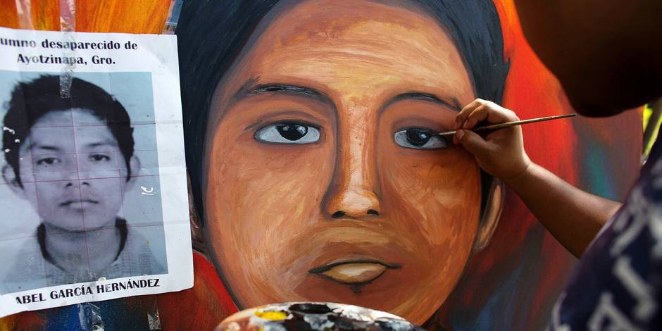 Local artist Florencio Sandoval paints a portrait of missing student Abel Garcia Hernandez, copying his likeness from his student photo, at the Isidro Burgos rural teachers college, in the Ayotzinapa district of Tixtla, Mexico, Wednesday, Oct. 29, 2014. A group of local artists are donating portraits of all 43 missing students, to be used for exhibitions, awareness raising, and eventually, gifts for the students' families. Classes remain on hold at the school, where classrooms have been converted to makeshift dormitories for hundreds of teachers and students from other schools who have come to support the students from Ayotzinapa.(AP Photo/Rebecca Blackwell)