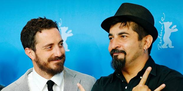 Director Pablo Larrain and actor Roberto Farias pose at the photo call for the film El Club at the 2015 Berlinale Film Festival in Berlin Monday,Feb. 9, 2015. (AP Photo/Axel Schmidt)