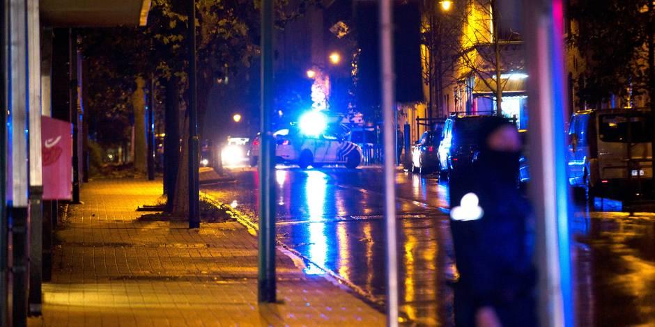 Attentats de Paris: Un photographe agressé lors des perquisitions à Molenbeek
