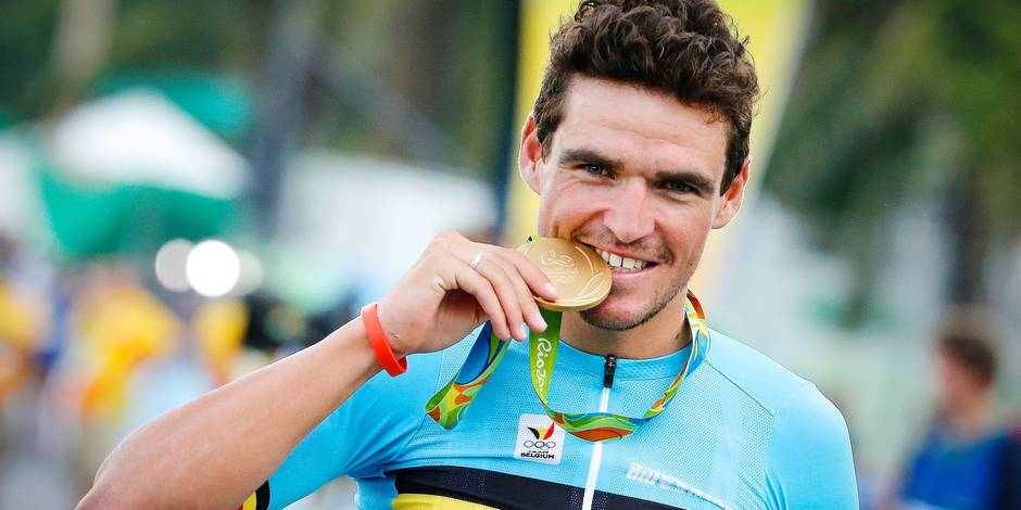 Belgium gold medal winner, olympic champion, Greg Van Avermaet celebrates with his medal on the podium of the men's road race cycling event at the 2016 Olympic Games in Rio de Janeiro, Brazil, Saturday 06 August 2016. BELGA PHOTO YUZURU SUNADA