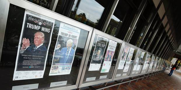Front pages from today's newspapers are viewed outside the Newseum in Washington,DC, the day after the US presidential election on November 9, 2016. / AFP PHOTO / YURI GRIPAS