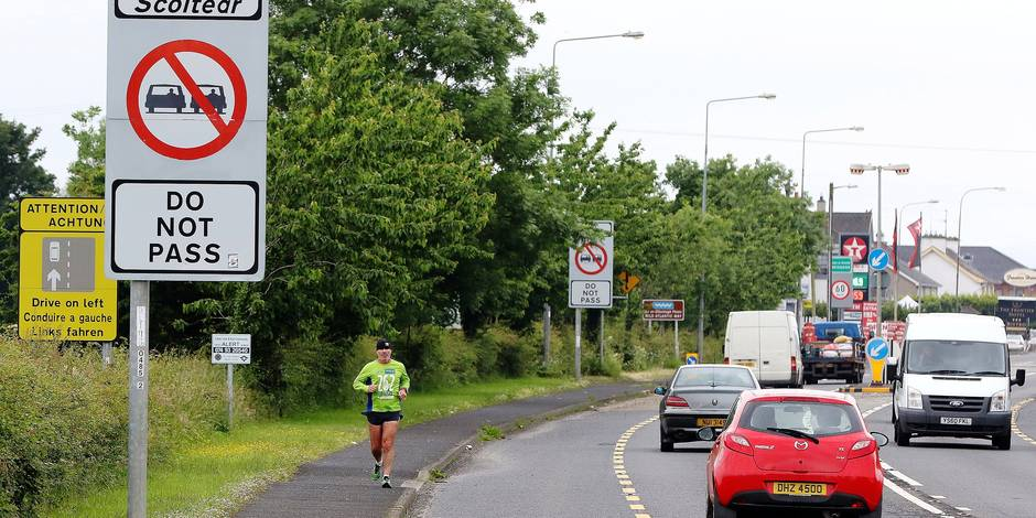 Cars cross the controless border between Northern Ireland and Ireland, in Derry in Northern Ireland, on June 25, 2016. The result of Britain's June 23 referendum vote to leave the European Union (EU) has pitted parents against children, cities against rural areas, north against south and university graduates against those with fewer qualifications. London, Scotland and Northern Ireland voted to remain in the EU but Wales and large swathes of England, particularly former industrial hubs in the north with many disaffected workers, backed a Brexit. / AFP PHOTO / PAUL FAITH