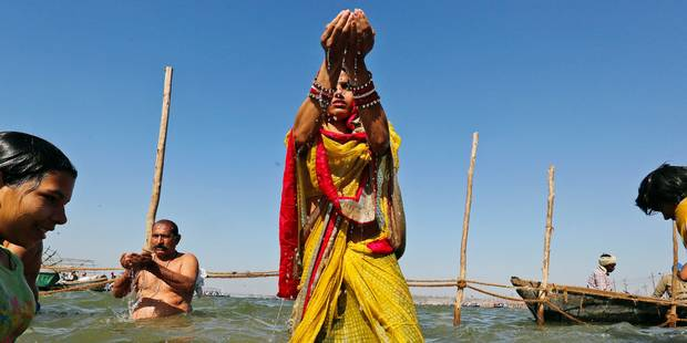 Hindu devotees offers prayers to the Sun god after taking a holy dip at the Sangam, the confluence of the Ganges and Yamuna and the mythical Saraswati, on the occasion of Hindu festival of Shivaratri, that marked the last day of the annual traditional fair of Magh Mela, in Allahabad, India , Friday, Feb. 24, 2017. Shivaratri, or the night of Shiva, is dedicated to the worship of Lord Shiva, the Hindu god of death and destruction. (AP Photo/Rajesh Kumar Singh)