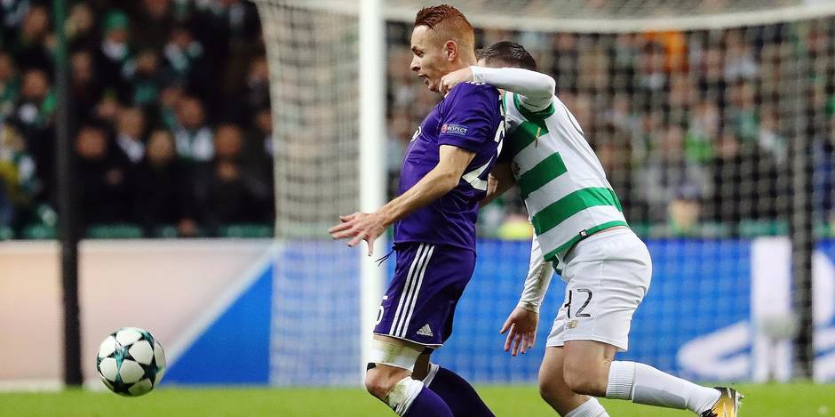 Anderlecht's Adrien Trebel and Celtic's Callum McGregor fight for the ball during a soccer game between Scottish team Celtic FC and Belgian club RSC Anderlecht, Tuesday 05 December 2017 in Glasgow, Scotland, the sixth and last game in the group stage of the UEFA Champions League competition. BELGA PHOTO VIRGINIE LEFOUR
