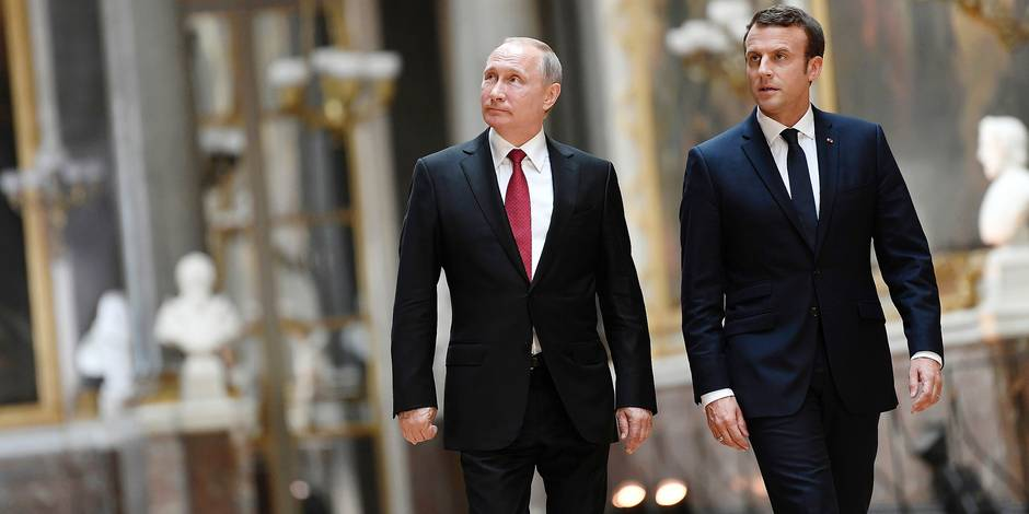 French President Emmanuel Macron, right, and Russian President Vladimir Putin walk in the Galerie des Batailles (Gallery of Battles) at the Versailles Palace as they arrive for a joint press conference following their meeting in Versailles, near Paris, France, Monday, May 29, 2017. Monday's meeting comes in the wake of the Group of Seven's summit over the weekend where relations with Russia were part of the agenda, making Macron the first Western leader to speak to Putin after the talks. (Stephane de Sakutin/Pool Photo via AP)