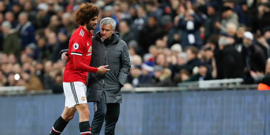"""(180201) -- LONDON, Feb. 1, 2018 (Xinhua) -- Jose Mourinho(R), manager of Manchester United hugs with Marouane Fellaini after he is substituted during the English Premier League football match between Tottenham Hotspur and Manchester United at the Wembley Stadium in London, Britain on Jan. 31, 2018. Hotspur won 2-0. (Xinhua/Han Yan) FOR EDITORIAL USE ONLY. NOT FOR SALE FOR MARKETING OR ADVERTISING CAMPAIGNS. NO USE WITH UNAUTHORIZED AUDIO, VIDEO, DATA, FIXTURE LISTS, CLUB/LEAGUE LOGOS OR """"LIVE"""" SERVICES. ONLINE IN-MATCH USE LIMITED TO 45 IMAGES, NO VIDEO EMULATION. NO USE IN BETTING, GAMES OR SINGLE CLUB/LEAGUE/PLAYER PUBLICATIONS."""