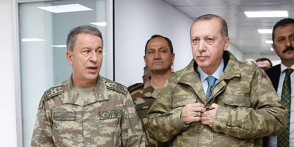 "(180125) -- HATAY (TURKEY), Jan. 25, 2018 () -- Turkish President Recep Tayyip Erdogan (R, Front) is accompanied by Turkish Chief of General Staff Hulusi Akar (L, Front) as he visits a military command center in Hatay, Turkey, on Jan. 25, 2018. Turkish President Recep Tayyip Erdogan on Thursday visited and inspected Turkish military command center in southern Hatay province, as the ""Operation Olive Branch"" in Syria's Afrin entered its sixth day. (/Turkish Presidential Palace) Reporters / Photoshot"
