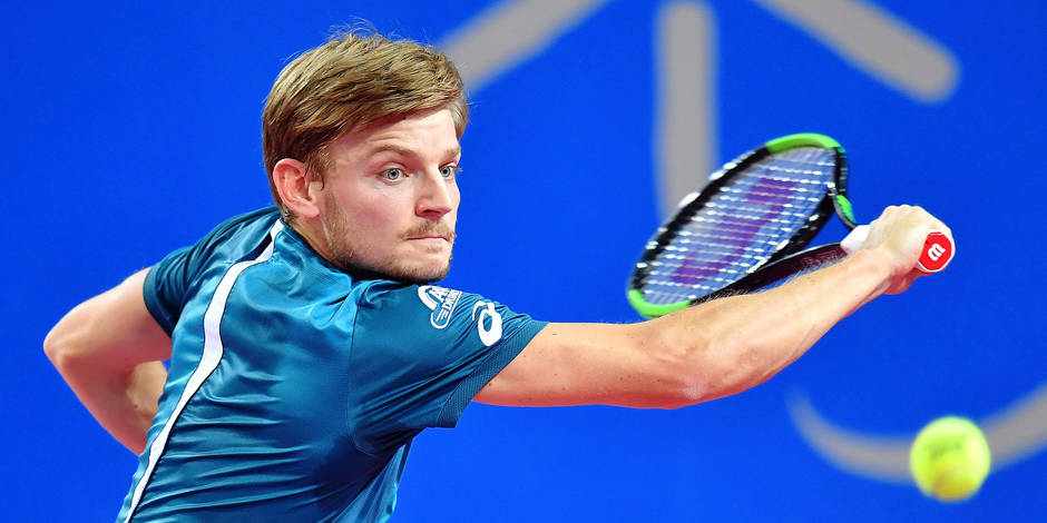David Goffin from Belgium returns the ball to Karen Khachanov during their tennis match at the Open Sud de France ATP World Tour in Montpellier, southern France, on February 9, 2018. / AFP PHOTO / PASCAL GUYOT