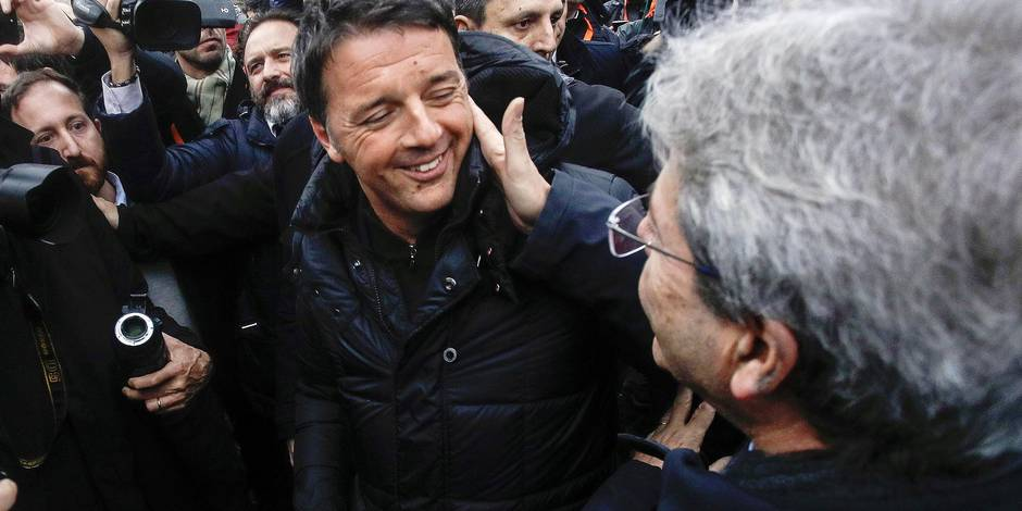 Italian Premier Minister Paolo Gentiloni, right, and former Premier Matteo Renzi meet at a march protesting racism and neo-fascism in Rome, Saturday, Feb. 24, 2018. Thousands of police have been deployed for protests Saturday in Rome, Milan and other Italian cities, seeking to prevent clashes during an election campaign that has increasingly been marked by violence. One Rome march protested racism and neo-fascism, while another targeted the center-left government's labor reforms. A third rally in Rome was opposing mandatory vaccines, which has become a campaign issue. (Giuseppe Lami/ANSA via AP)