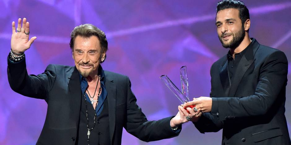 NEWS PICTURES FRANCE, Paris : French singer Johnny Hallyday (L) gestures as he receives the best album award composed by Maxim Nucci alias Yodelice Æ, during the 31st Victoires de la Musique, the annual French music awards ceremony, on February 12, 2016 at the Zenith concert hall in Paris.?©FRANCK CASTEL Reporters / NewsPictures