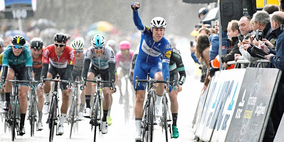 Dutch Fabio Jakobsen of Quick-Step Floors (R) celebrates as he wins the sprint at the finish line of the 106th edition of the 'Scheldeprijs' one day cycling race, 200,4 km from Borsele to Schoten, Wednesday 04 April 2018. BELGA PHOTO YORICK JANSENS